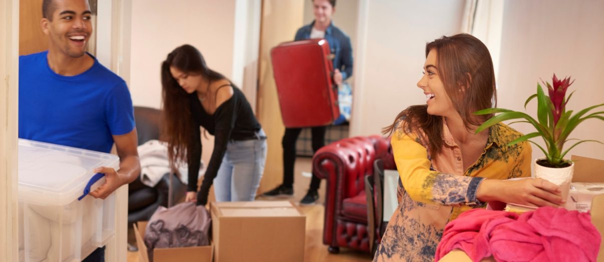 Young-friends-moving-in-iStock-497390216-1