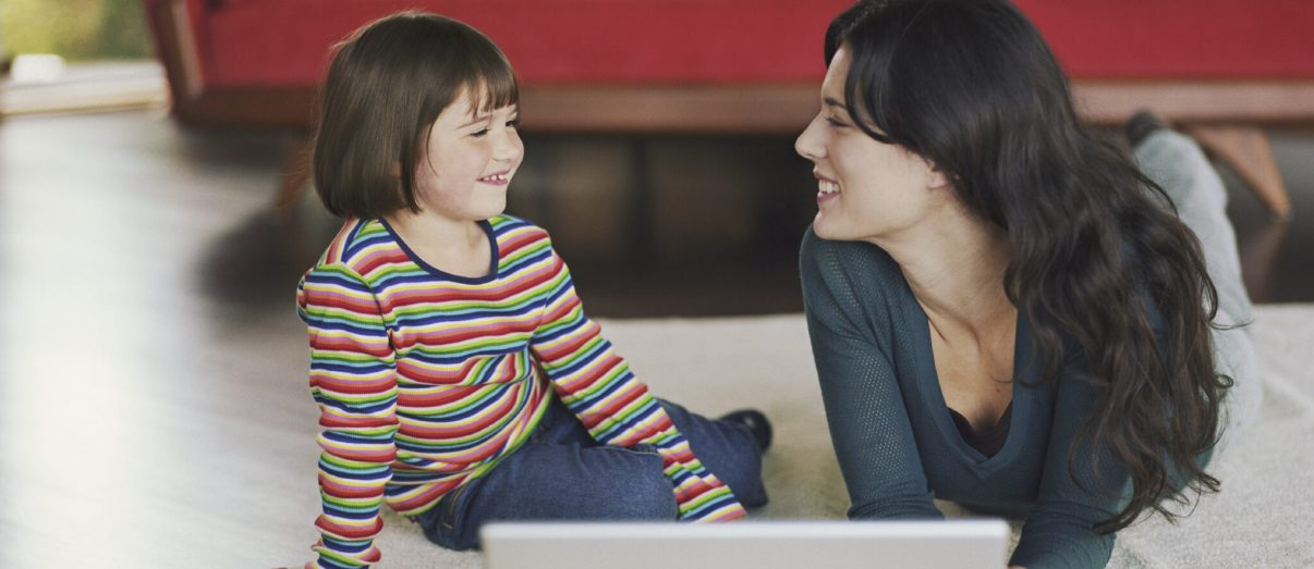 mom-with-child-and-laptop-2iStock_000020608236