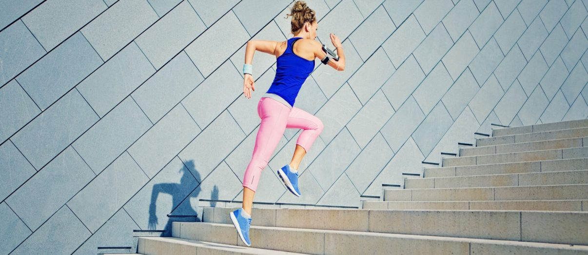 woman-running-up-stairs-in-activewear-iStock-825721894