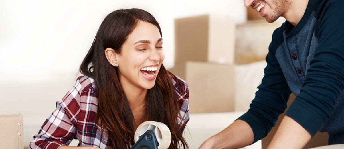 young-couple-moving-to-first-house-iStock-897324296-1