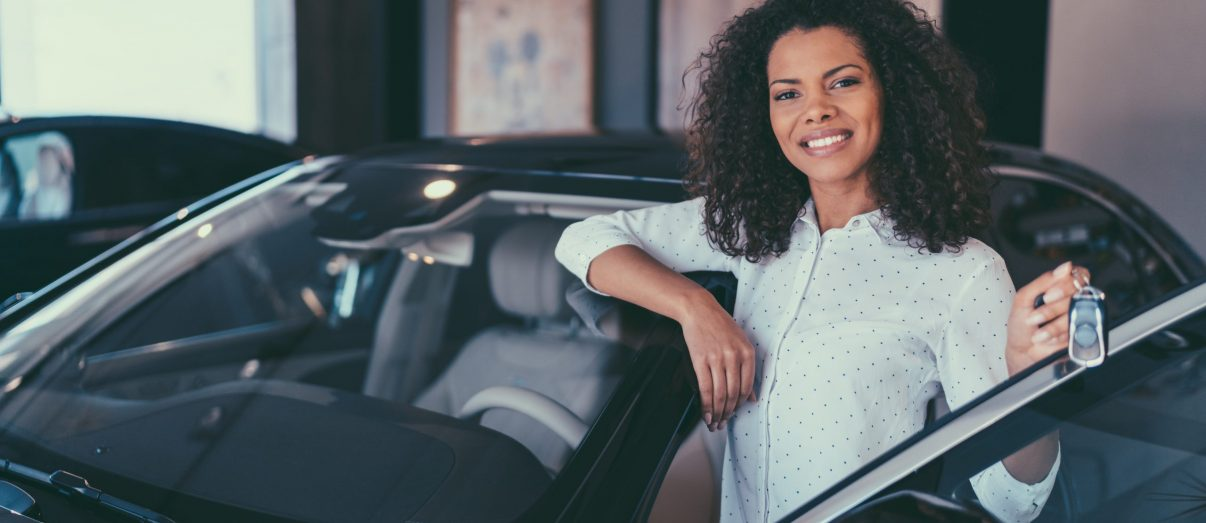 young-woman-buying-new-car-iStock-1039931504